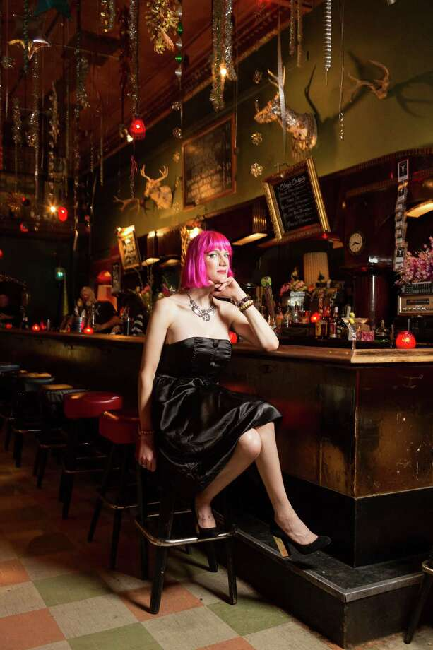 Charlie Jane Anders founded Writers with Drinks, held each month at the Make Out Room in the Mission, a slightly inebriated but literary, serious event where writers read from their work. Here, Anders is at the bar. Photo: Jason Henry / Special To The Chronicle / ONLINE_YES