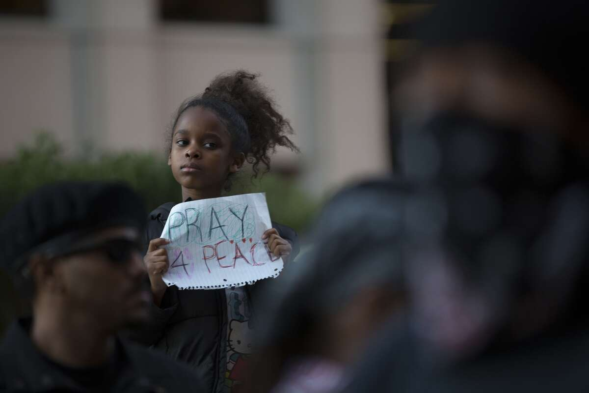 Kennedy Hawkins, 7, holds a sign at a rally in the 1200 block of Smith on Wednesday, Nov. 26. It was the second demonstration that protested the decision not to indict officer Darren Wilson in the death of unarmed teen Michael Brown.