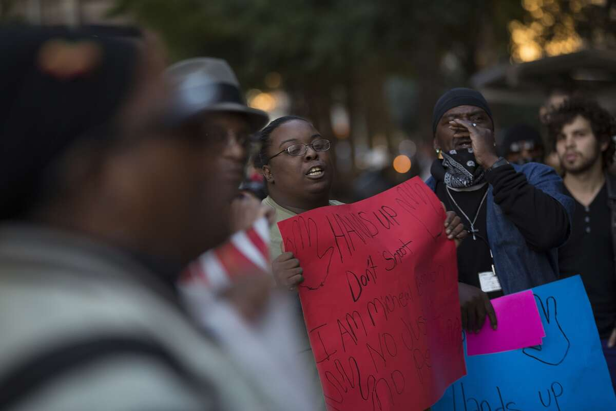 About 30 people rallied with members of the National Black United Front in Houston.