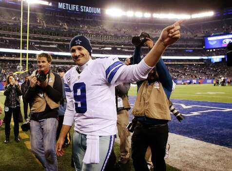 Dallas Cowboys quarterback Tony Romo (9) waves to fans as he walks off the field after the Cowboys beat the  New York Giants 31-28 in an NFL football game, Sunday, Nov. 23, 2014, in East Rutherford, N.J. (AP Photo/Kathy Willens) Photo: Kathy Willens, STF / Associated Press / AP