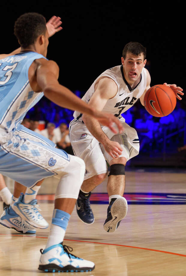 Alexander Barlow (3) drives on J.P. Tokoto during Butler's second early-season upset of North Carolina in three years. Photo: Tim Aylen / Associated Press / AP