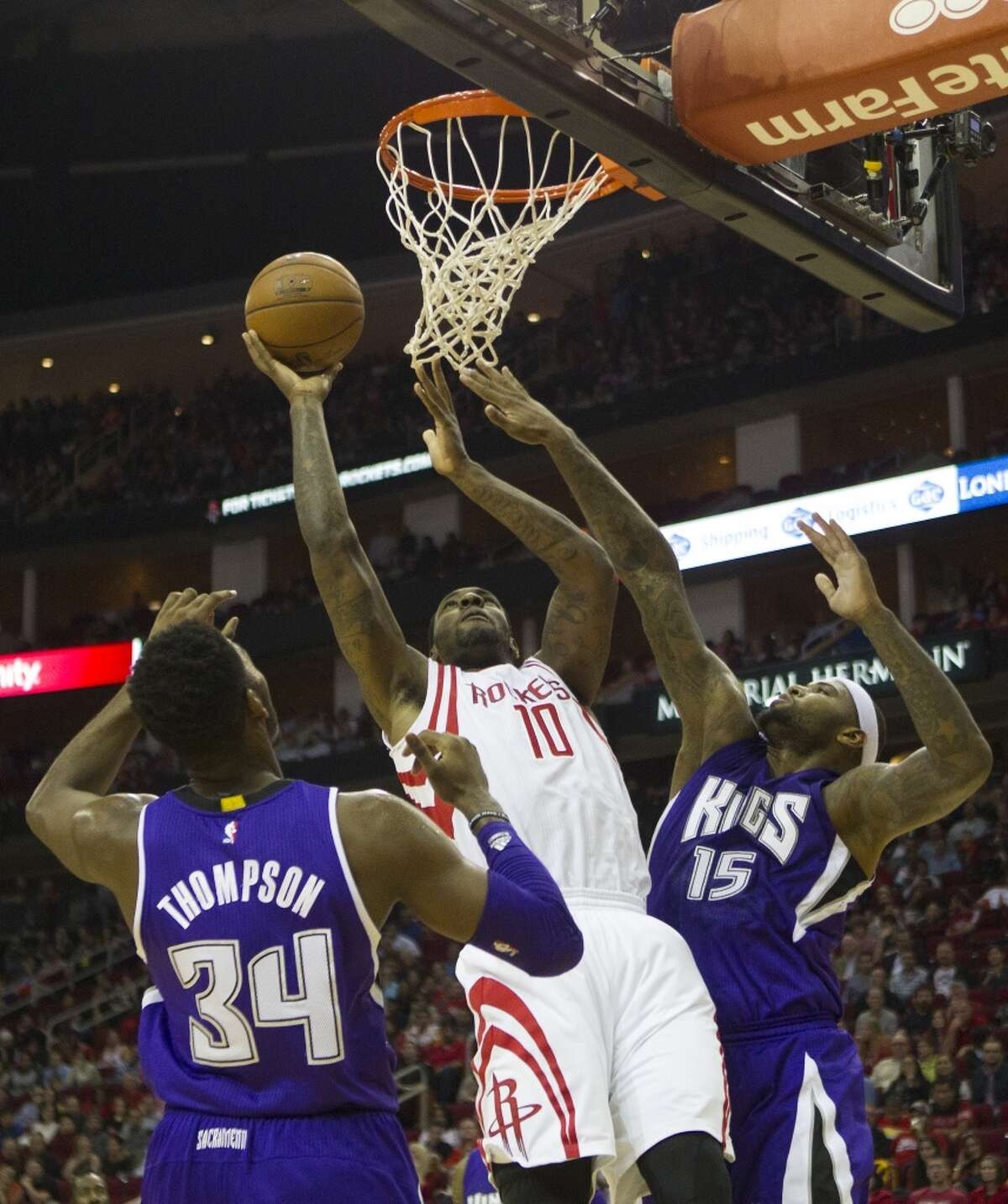 Sacramento Kings forward Jason Thompson and center DeMarcus Cousins defend as Houston Rockets forward Tarik Black goes up for a shot during the second half of an NBA game at the Toyota Center, Wednesday, Nov. 26, 2014, in Houston. (Cody Duty / Houston Chronicle)