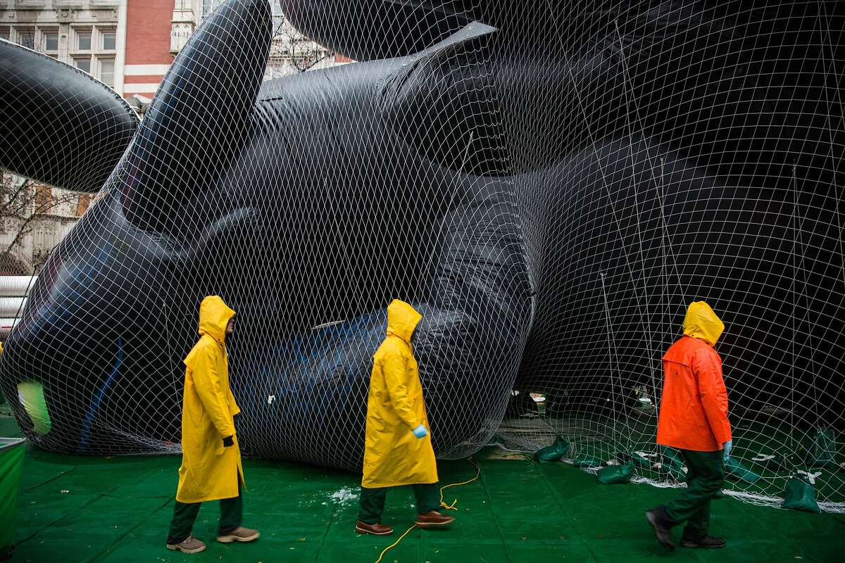 NEW YORK, NY - NOVEMBER 26: Workers help inflate balloon floats with helium in preparation for the annual Macy's Thanksgiving Day Parade on November 26, 2014 in New York City. The parade will be broadcast from 9 a.m. to 12 p.m. on NBC Thanksgiving morning. (Photo by Andrew Burton/Getty Images)