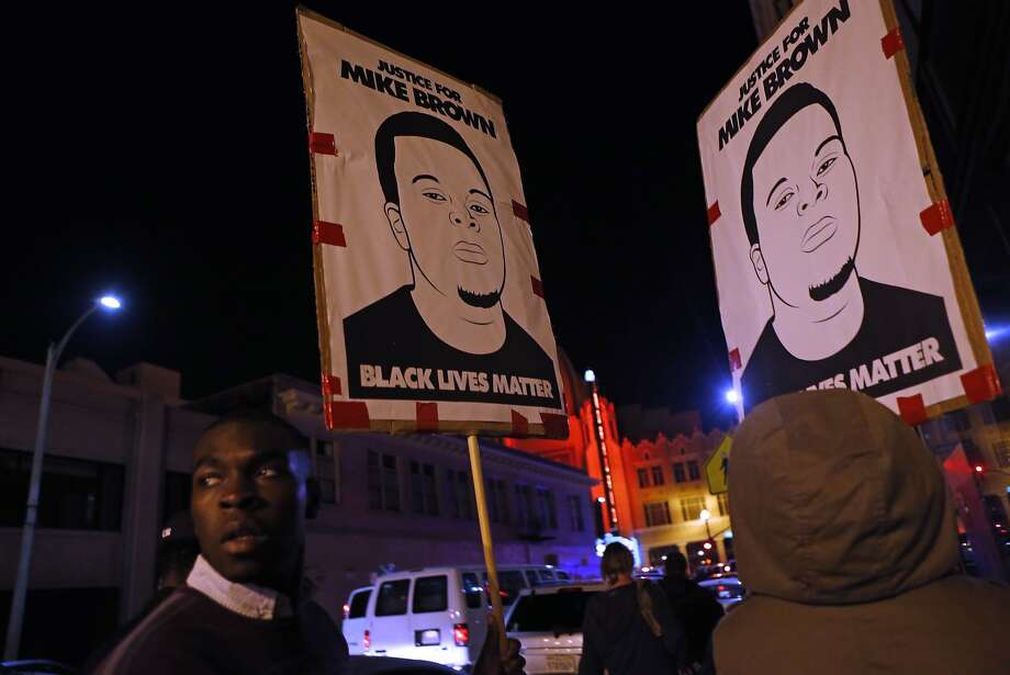 A protester looks back while marching during Ferguson related protests in Oakland, Calif., on Wednesday, November 26, 2014. Photo: Scott Strazzante, The Chronicle