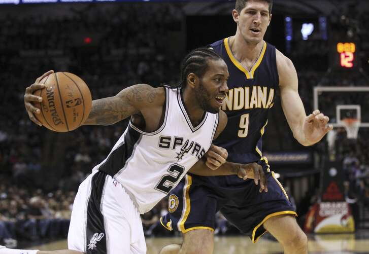 Spurs' Kawhi Leonard (02) tries to drive around Indiana Pacers' Damjan Rudez (09) at the AT&T Center on Wednesday, Nov. 26, 2014.  (Kin Man Hui/San Antonio Express-News)