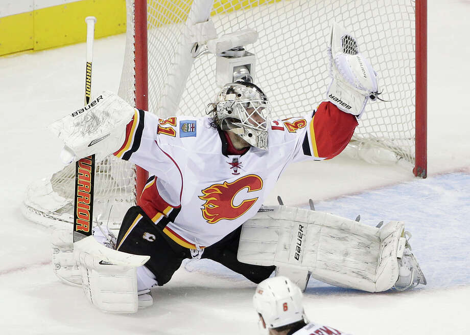 Calgary Flames goalie Karri Ramo, of Finland, stops a shot from the San Jose Sharks during the second period of an NHL hockey game Wednesday, Nov. 26, 2014, in San Jose, Calif. (AP Photo/Marcio Jose Sanchez) Photo: Marcio Jose Sanchez / Associated Press / AP