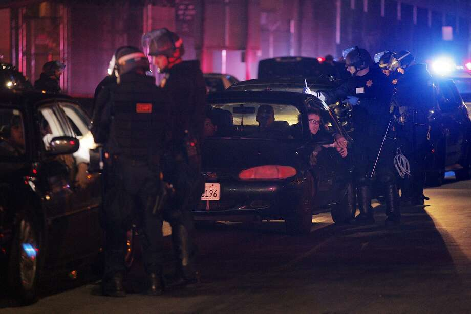 In this Nov. 26, 2014 photo, CHP officers process several people who were detained after a raid of a large sideshow event on Maritime Street in Oakland. Photo: Carlos Avila Gonzalez, The Chronicle
