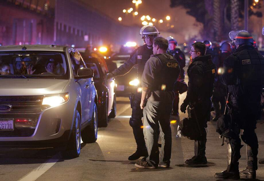 Police cite drivers at a large sideshow event held on Oakland's Maritime Street last November. Photo: Carlos Avila Gonzalez, The Chronicle