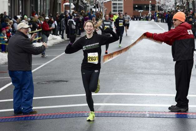 Kerry Caher, 20, of Clifton Park was the first woman to fnish the Troy Turkey Trot 5K on Thursday, Nov. 27, 2014. (Skip Dickstein/Times Union)