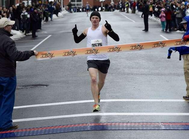 Brandon Allen of Windsor, Ontario, won the Troy Turkey Trot 5K on Thursday, Nov. 27, 2014. (Skip Dickstein/Times Union)