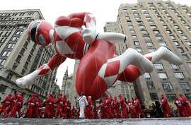 A Power Ranger balloon cruises along Central Park West during the Macy's Thanksgiving Day Parade, Thursday, Nov. 27, 2014, in New York. (AP Photo/Julio Cortez)