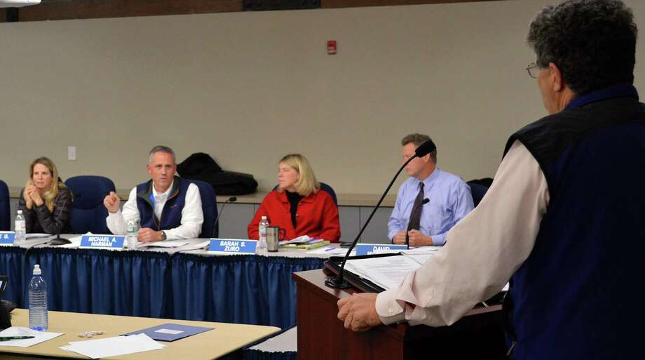 "Board of Education members questioned David Campbell, chairman of the town's ""shuffle"" building committee, about renovations at 35 Leroy Ave., but he assured them that problems at the renovated building are being resolved. Photo: Jarret Liotta / Darien News"
