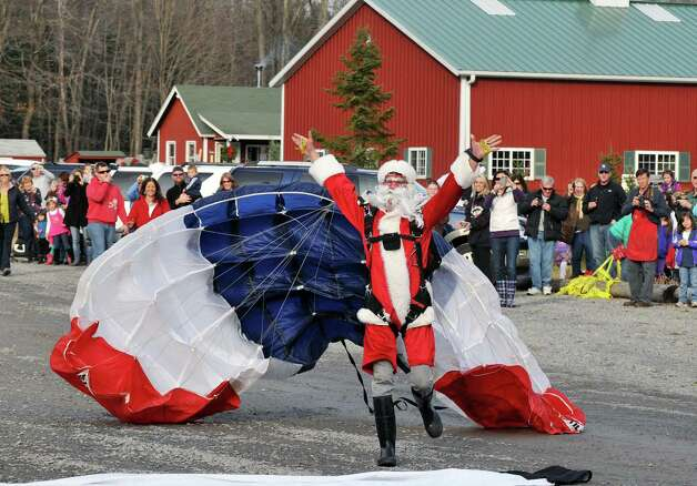 Santa Claus parachutes into the Ellms Christmas Tree farm  in Charlton Saturday Nov. 26, 2011.   (John Carl D'Annibale / Times Union archive) Photo: John Carl D'Annibale / 00015520A