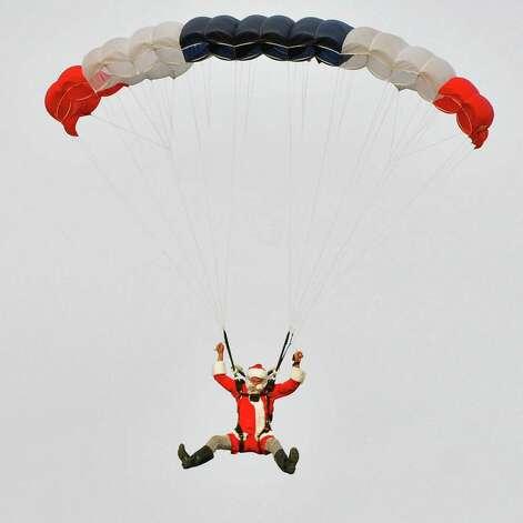 Santa Claus parachutes into the Ellms Christmas Tree farm with a team from Saratoga Skydiving Adventures in Charlton Saurday Nov. 26, 2011.   (John Carl D'Annibale / Times Union archive) Photo: John Carl D'Annibale / 00015520A