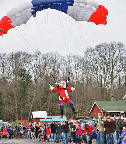 Santa parachutes in to the Ellms  Christmas Tree Farm Saturday Nov. 30, 2013, in Ballston Spa, NY.  (John Carl D'Annibale / Times Union archive) Photo: John Carl D'Annibale / 00024698A
