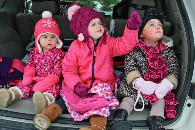 Watching as Santa parachutes in to the Ellms  Christmas Tree Farm are from left, Piper Brantley, 1, Chloe Brantley, 3, and Gianna Nielsen, 2, all of Porter Corners, Saturday Nov. 30, 2013, in Ballston Spa, NY.  (John Carl D'Annibale / Times Union archive) Photo: John Carl D'Annibale / 00024698A