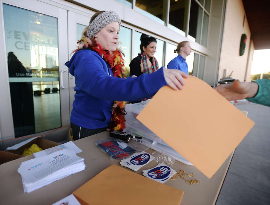 Sarah Zarate works the sign-in table at the Turkey Trot on Thursday morning. The Sea Rim Striders hosted the Triangle Therapeutics Turkey Trot 5K, 10K and Kids K at the Event Centre on Thursday morning. The races attracted a little over 1,500 participants.