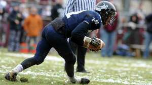 Scenes from the annual Thanksgiving day game between Ansonia and Naugatuck High Schools Thursday, Nov. 27, 2014, at Nolan Field in Ansonia, Conn.