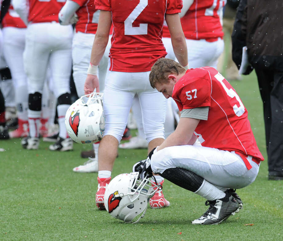 Jake Herman (#57) of Greenwich kneels and bows his head in the final minute of the Thanksgiving Day high school football game between Greenwich High School and Staples High School at Greenwich, Conn., Thursday, Nov. 27, 2014. Staples defeated Greenwich by a score of 38-21. Photo: Bob Luckey / Greenwich Time