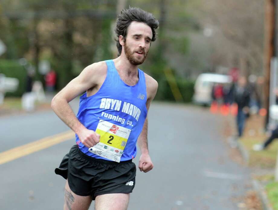Cameron Marantz, of Philadelphia, Penn., is the top finisher with a time of 24:10 Thursday, Nov. 27, 2014, during the 37th Annual Pequot Runners Thanksgiving Day Race in Southport, Conn. Photo: Autumn Driscoll / Connecticut Post