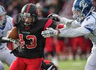 Fairfield Warde high school running back Jack Whiting tries to get through the Fairfield Ludlowe high school defense during their annual Thanksgiving football game played this year at Warde high school, Fairfield, CT on Thursday, November, 27th, 2014.