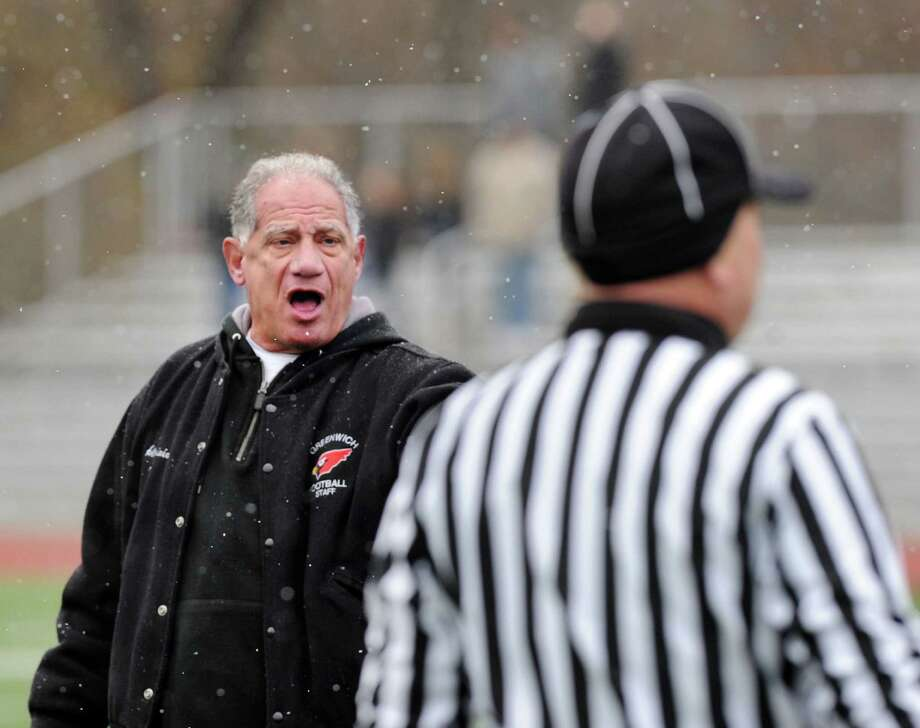 Greenwich High School football coach Rich Albonizio hollars at a referee during the Thanksgiving Day high school football game between Greenwich High School and Staples High School at Greenwich, Conn., Thursday, Nov. 27, 2014. Staples defeated Greenwich by a score of 38-21. Photo: Bob Luckey / Greenwich Time