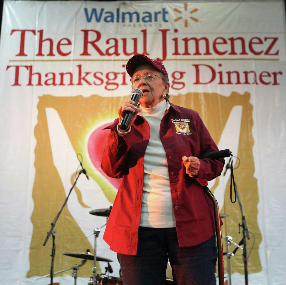 Mary Jimenez, wife of Raul Jimenez, addresses an audience at the 35th Annual Raul Jimenez Thanksgiving Dinner at the Convention Center on Thursday, Nov. 27, 2014. Each year about 25,000 guests gather for a Thanksgiving meal hosted by Patricia Jimenez who has overseen the event since the passing of her father who started the charitable event 35 years ago. Mary Jimenez died Tuesday, June 4, 2019, at the age of 87. Photo: Kin Man Hui, San Antonio Express-News / ©2014 San Antonio Express-News
