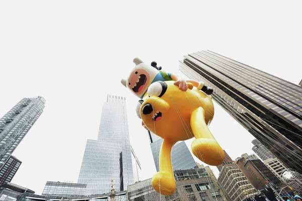 NEW YORK, NY - NOVEMBER 27:  The Finn 'n Jake Adventure Time balloon passes by during the 88th annual Macy's Thanksgiving Day Parade on November 27, 2014 in New York City. Over 8,000 people took part in the parade and it is estimated that over three million people were in attendance.