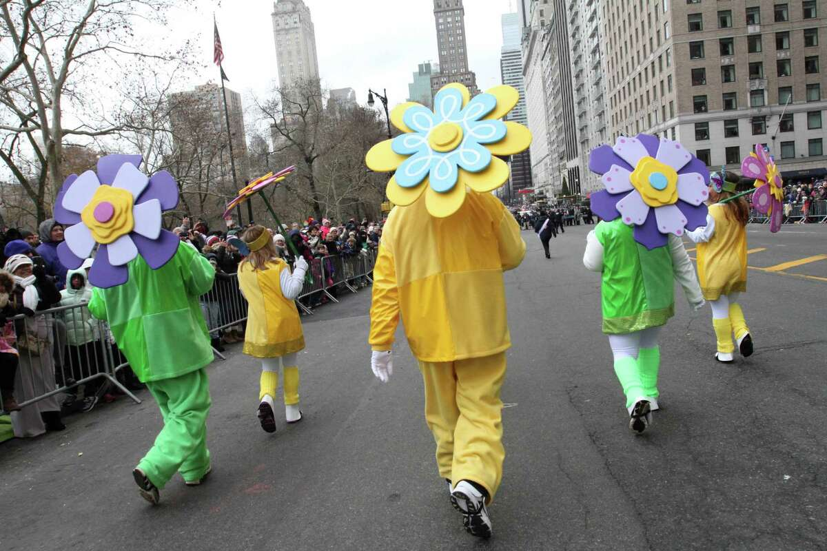 Costumed participants make their way across New York's Central Park South during the Macy's Thanksgiving Day Parade, Thursday Nov. 27, 2014.