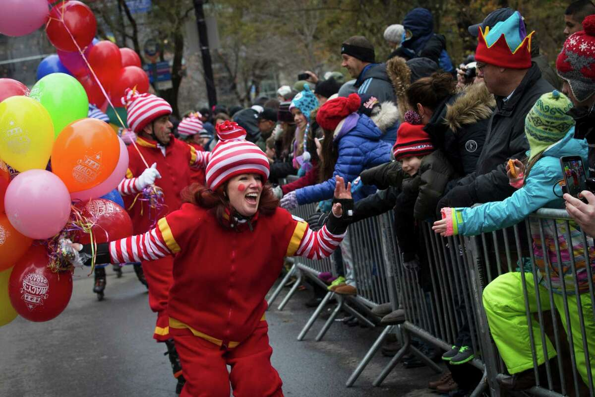 A performer cheers as she skates by spectators during the Macy's Thanksgiving Day Parade, Thursday, Nov. 27, 2014, in New York.