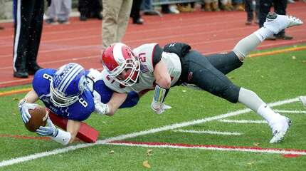 Darien's Colin Minicus dives into the endzone for a touchdown during the FCIAC championship game between New Canaan High School and Darien High School in Stamford, Conn., on Thanksgiving Day, Thursday, November 27, 2014.