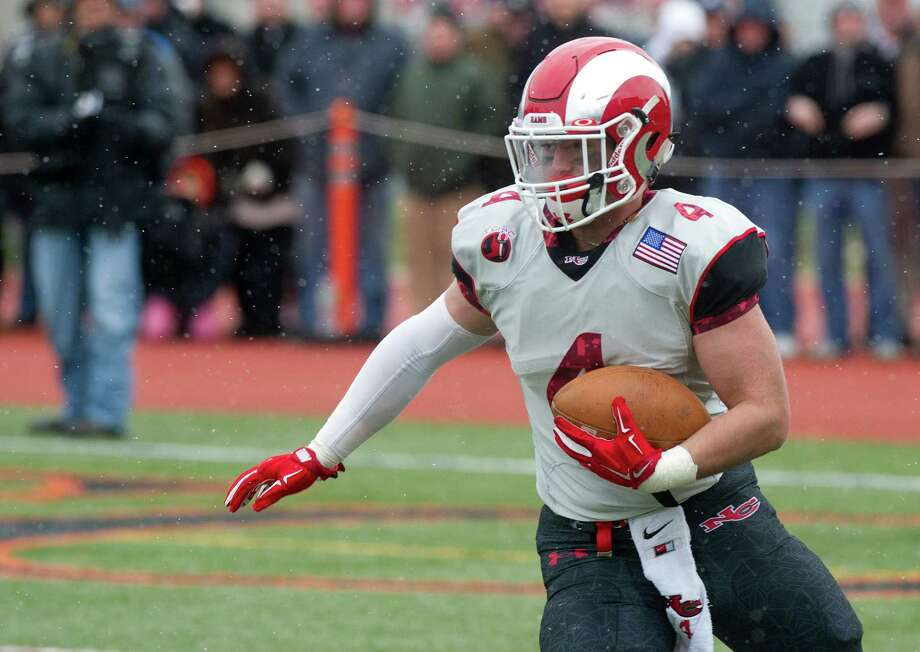 Seventeen of the 32 teams in this year's high school football playoff field appeared in the postseason a year ago, including defending champions Southington (LL), New Canaan (L), St. Joseph (M) and Ansonia (S). Photo: Lindsay Perry / Stamford Advocate