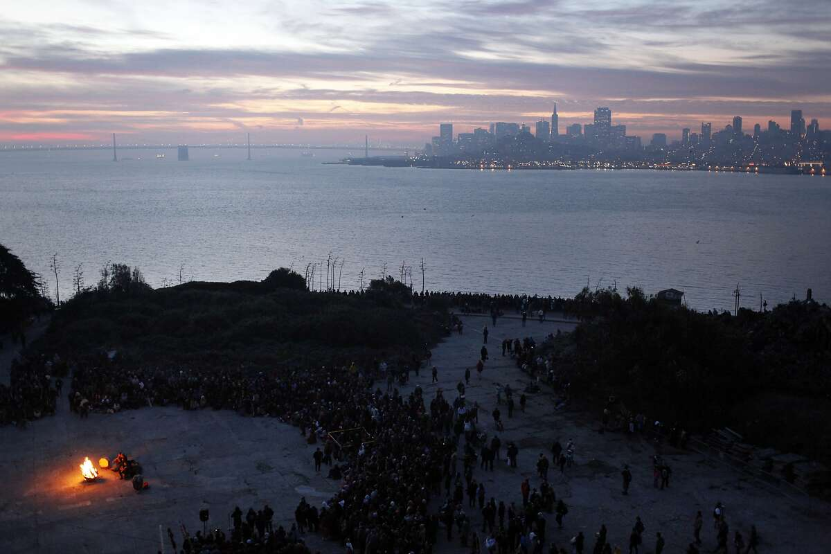 Onlookers form a circle around a bonfire at theIndigenous Peoples' Day Sunrise Gatheringon Alcatraz Island on November 27, 2014 in San Francisco, Calif. The 39th annual celebration, previously called