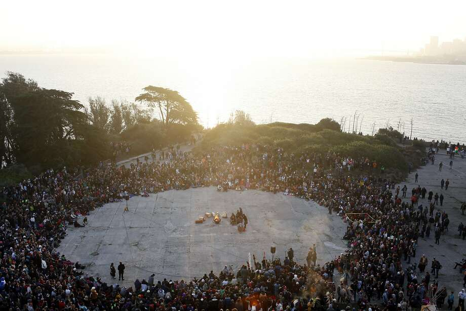 Onlookers form a circle around a bonfire at the Indigenous People's Sunrise Gathering on Alcatraz Island. Photo: Pete Kiehart, The Chronicle