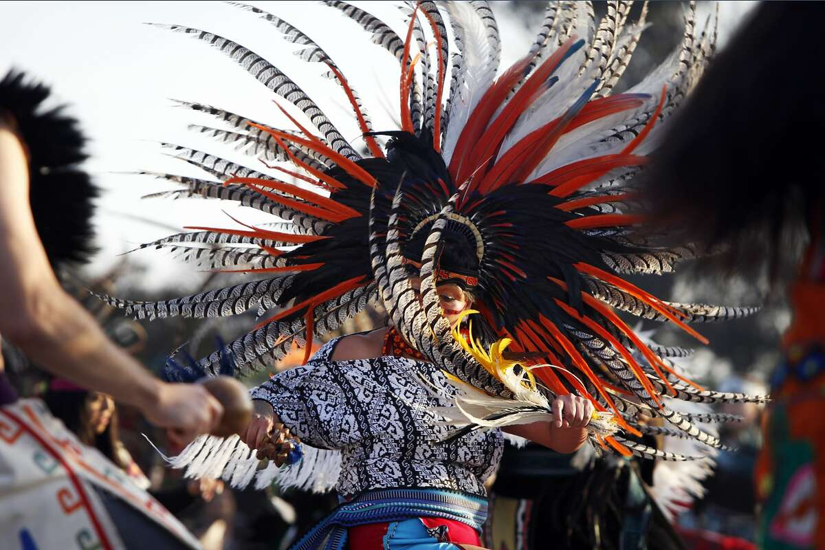 A participant dances at the Indigenous People's Sunrise Gathering on Alcatraz Island on November 27, 2014 in San Francisco, Calif.