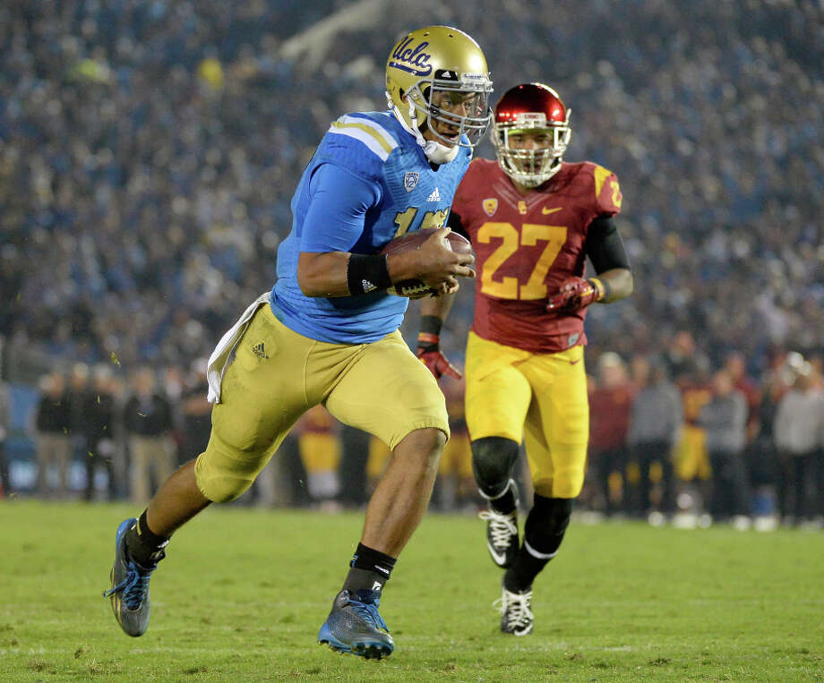 Brett Hundley's running ability is one reason why UCLA usually scores when it reaches the red zone. Photo: Harry How / Getty Images / 2014 Getty Images