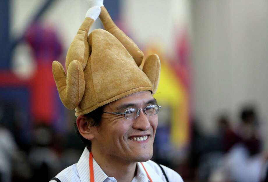 Volunteer Mark Takayama greets guests at the 36th Annual Thanksgiving Big Feast presented by the City Wide Club at the George R. Brown Convention Center Thursday, Nov. 27, 2014, in Houston, Texas. Organizers expect to serve between 25,000 and 30,000 people, distribute more than 500,000 pieces of clothing, blankets, jackets and other household items and offer free medical screenings. Photo: Gary Coronado, Houston Chronicle / © 2014 Houston Chronicle