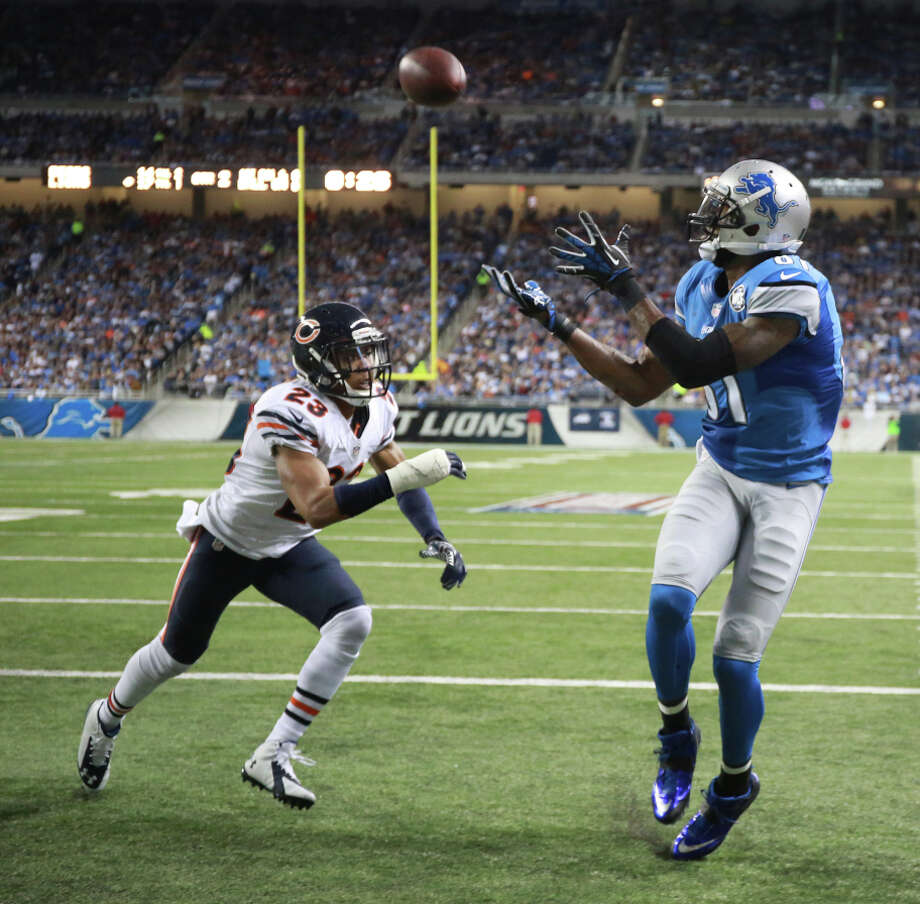 Calvin Johnson catches a second-quarter TD in his 115th game on his way to becoming the fastest to 10,000 yards receiving. Photo: John J. Kim / McClatchy-Tribune News Service / Chicago Tribune