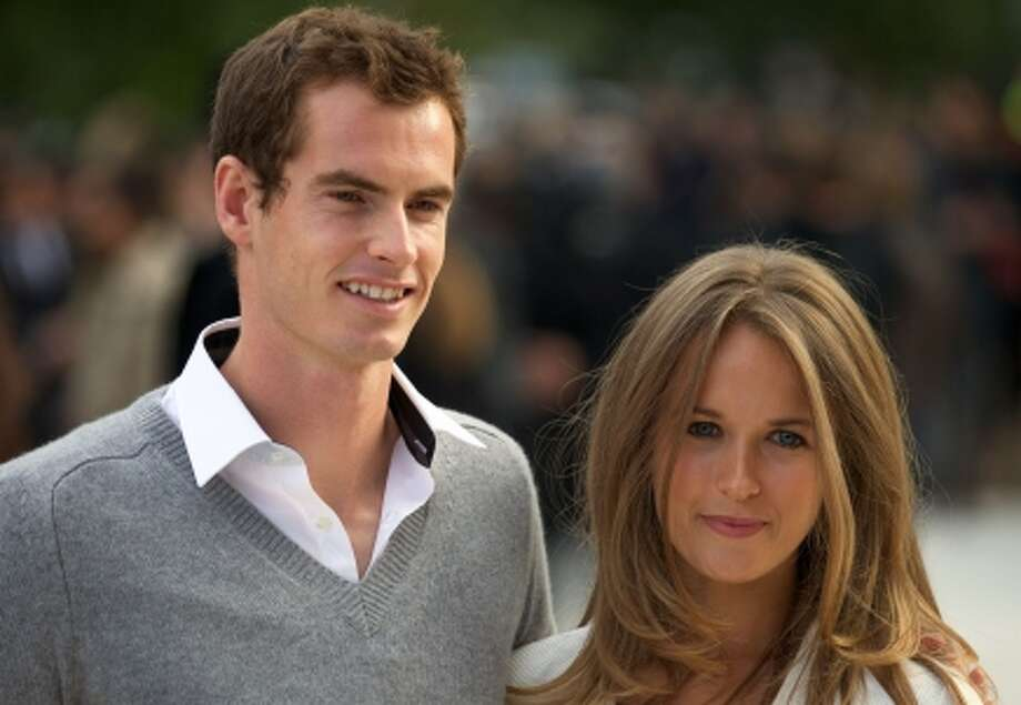 (FILES) In a file picture taken on September 17, 2012 British tennis player Andy Murray (L) and girlfriend Kim Sears (R) pose as they arrive to attend the Burberry Prorsum 2013 spring/summer collection catwalk show at London Fashion Week in London. Andy Murray announced his engagement to longtime girlfriend Kim Sears on November 26, 2014 while also dispensing with two members of his backroom staff in Dani Vallverdu and Jez Green. AFP PHOTO / ANDREW COWIEANDREW COWIE/AFP/Getty Images Photo: ANDREW COWIE / AFP/Getty Images / AFP
