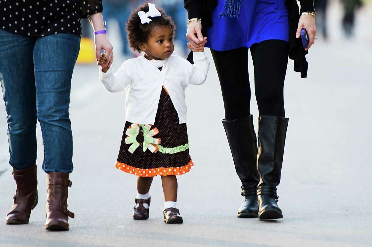 A youngster arrives for the 28th Annual Uptown Houston Holiday Lighting on Thursday, Nov. 27, 2014, in Houston.