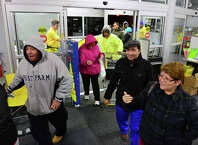 Holiday shoppers waited in long lines to take advantage of Thanksgiving pre-black Friday deals at the Best Buy at Hawley Lane in Trumbull, Conn. which opened at 5 p.m. on Thursday Nov. 27, 2014.