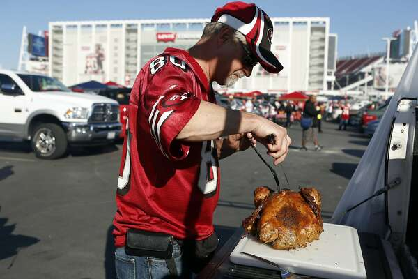 San Francisco 49ers' Randy Richey carves a Thanksgiving turkey before  the Niners play the Seattle Seahawks in NFL game at Levi's Stadium in Santa Clara, Calif., on Thursday, November 27, 2014.