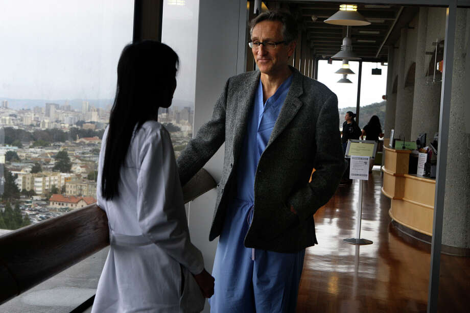 Dr. Chuter talks to his wife, Dr. Jade Hiramoto, also a vascular surgeon at UCSF, while on break at the hospital in San Francisco. Photo: Liz Hafalia / The Chronicle / ONLINE_YES
