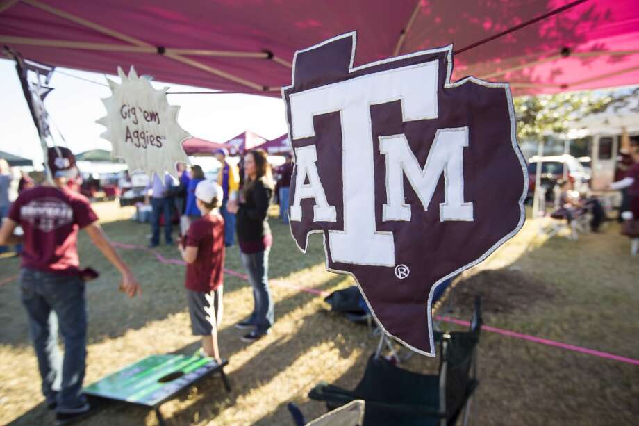 A Texas A&M logo hangs in a tent before the Thanksgiving Day game between Texas A&M and LSU at Kyle Field Thursday, Nov. 27, 2014, in College Station. ( Brett Coomer / Houston Chronicle ) Photo: Houston Chronicle