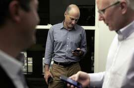 L-R, Sean Clegg, Dan Newman, and Ace Smith check their smarphones in their offices at SCN Strategies in San Francisco, Calif., on Sunday, November 23, 2014. The 2014 elections marked a dismal result for democrats across the nation, but local political strategists Ace Smith, Dan Newman, and Sean Clegg, notched a perfect 10 for 10 with wins in big races for clients like Jerry Brown, Kamala Harris, Libby Schaff, and Gavin Newsom.