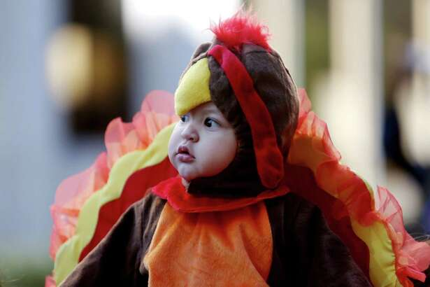 Carmelo Suarez, 11-months, at his first 65th Annual H-E-B Thanksgiving Day Parade in Houston, Texas.