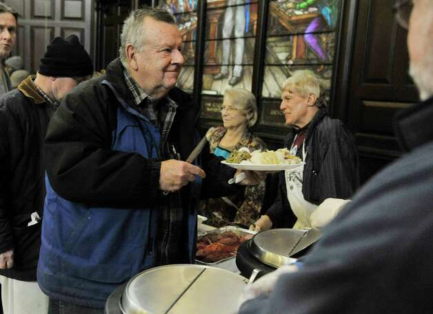 Jack Howard of Latham thanks the volunteers as he gets his food at the annual Equinox Thanksgiving Day Community Dinner at the First Presbyterian Church on Thursday, Nov. 27, 2014, in Albany, N.Y.  (Paul Buckowski / Times Union) Photo: Paul Buckowski / 00029628A