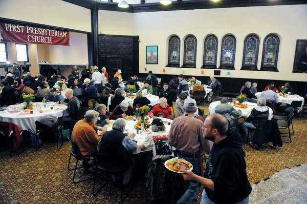 Guests enjoy food at the annual Equinox Thanksgiving Day Community Dinner at the First Presbyterian Church on Thursday, Nov. 27, 2014, in Albany, N.Y.  (Paul Buckowski / Times Union) Photo: Paul Buckowski / 00029628A