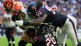 Texans outside linebacker Jadeveon Clowney (90), who was in on about 60 percent of the defensive plays against Cincinnati on Sunday, has not been able to practice this week because of swelling in his surgically repaired knee.