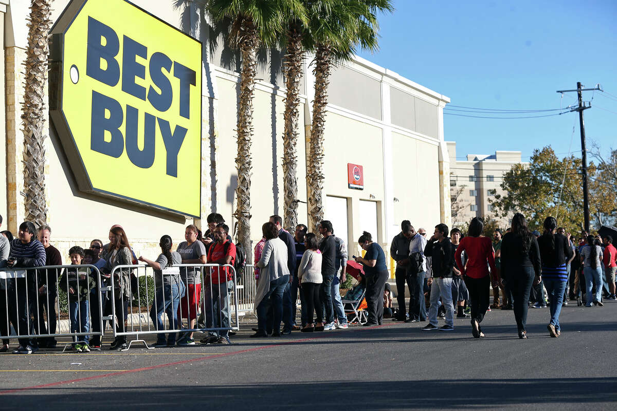 The line goes around the back of the store as shoppers wait to crowd into the Best Buy store at the Rim Shopping Center on November 27, 2014.